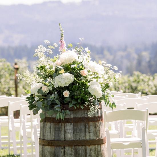 Large arrangement on wine barrel