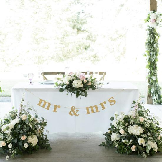 low and wide with large arrangements from ceremony